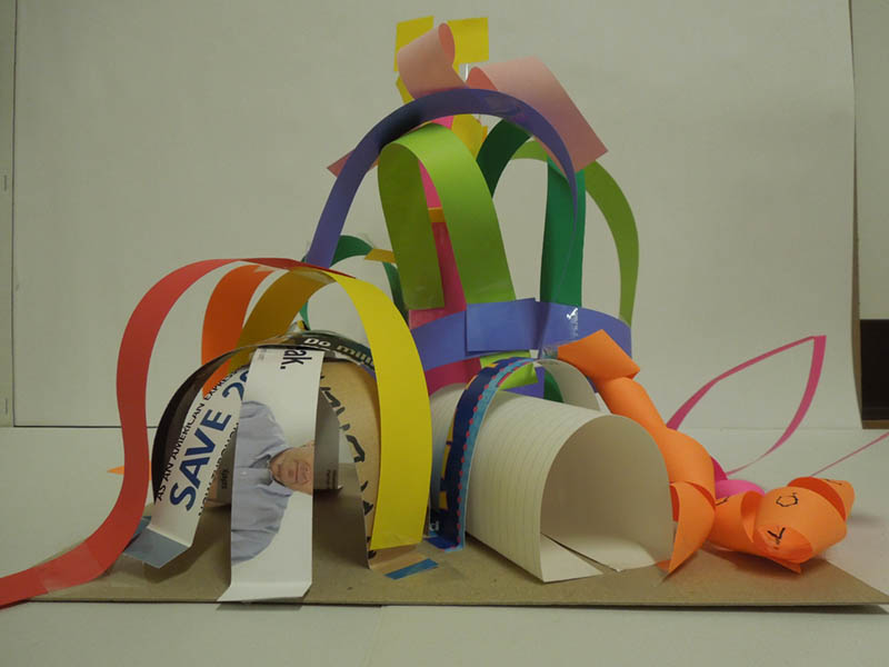 An architectural playground model with cardboard strips